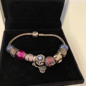 Pandora bracelet with box and charms